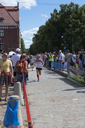 VYBORG, RUSSIA - JULY 20, 2012: The second half-marathon in running in Vyborg city. Running sportsmen on July 20, 2012 in Vyborg, Russia.