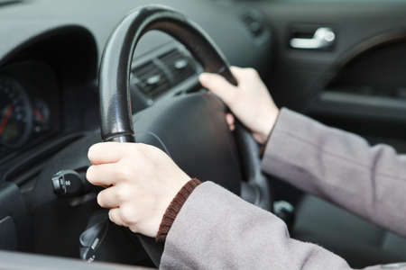 Right hands position on steering wheel during driving a car photo
