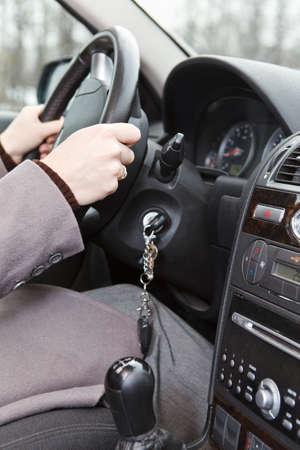 Women hands on steering wheel in land vehicle photo