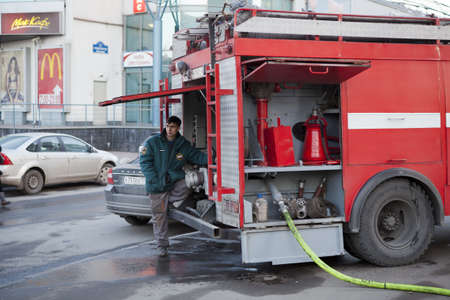 SAINT-PETERSBURG, RUSSIA - CIRCA MARCH, 2012: Firefighter and red fire truck, on circa March, 2012 in Saint-Petersburg, Russia