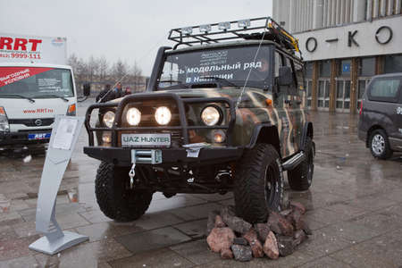 SAINT-PETERSBURG, RUSSIA - CIRCA MARCH, 2012: UAZ Hunter on exhibition near Sport Concert Arena, on circa March, 2012 in Saint-Petersburg, Russia Stock Photo - 15293718