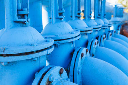 gas supply: Close up of line from blue oxigen gate valves with pipes