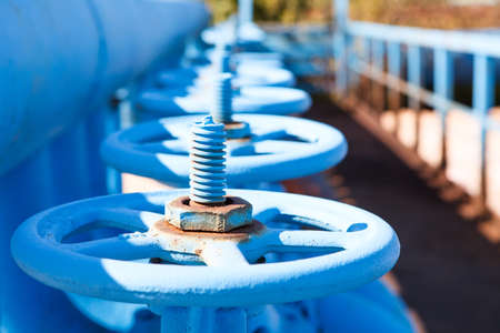 Close up of line from blue vents of oxigen gate valves Stock Photo
