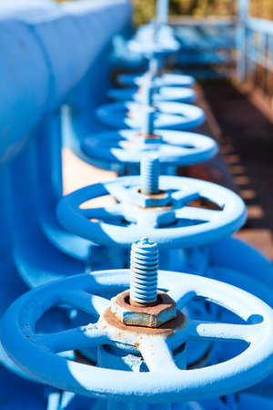oxigen: Line from blue vents of oxigen gate valves Stock Photo