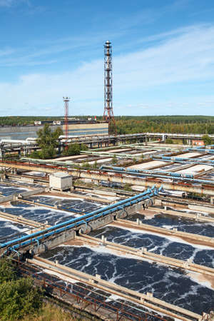 Industrial water treatment plant in evergreen forests photo