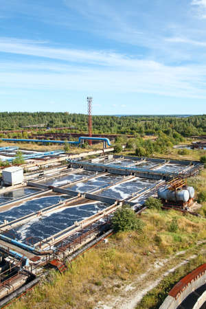 greywater: Industrial water treatment plant in evergreen forests Stock Photo