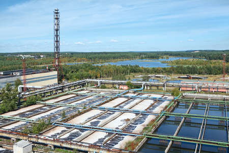 Aerial view of water treatment plant in evergreen woods