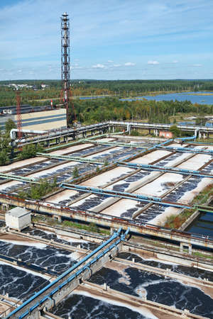 Aerial view of industrial water treatment plant in evergreen forests