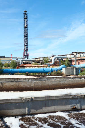 effluent: Water treatment plant view with chimney and blue sky
