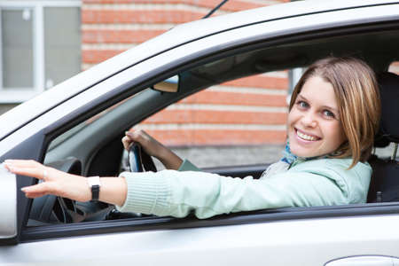 Happy Caucasian woman on driver s seat in own car photo