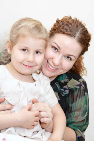 Portrait of happy mother with daughter faces together photo