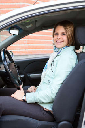 vehicle interior: Young woman on driver seat in car Stock Photo
