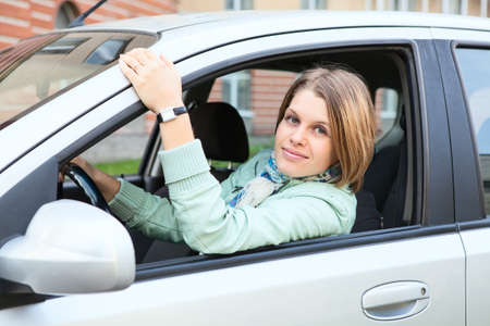Woman with blond hair in land vehicle photo