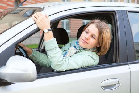 Female driver looking forvard from vehicle window photo