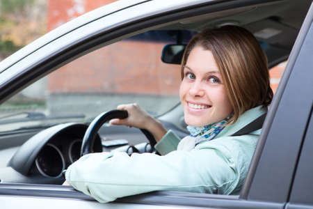 Female driver looking back from car window Stock Photo - 15781491
