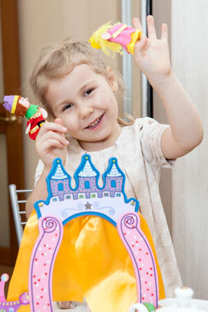 Happy playing Caucasian child with finger theater game and stage photo