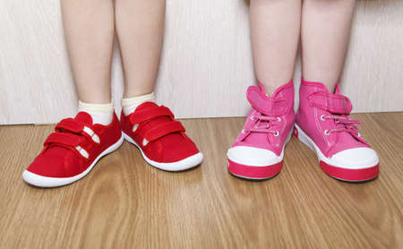 Children in wrong feet and right feet shoes wearing on legs Stock Photo - 16086811