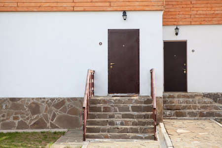 porches: Two standart doors with porches in townhouse Stock Photo