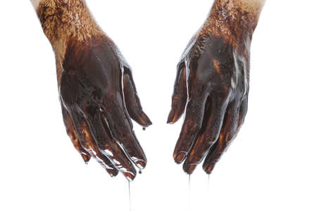 dirty man: Caucasian hands stained with black oil isolated on white background Stock Photo