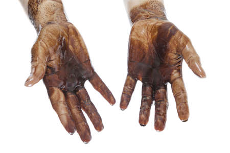 naphtha: Caucasian hands stained with black petroleum isolated on white background