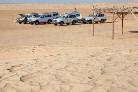 Off-road car at stoppage in Sahara desert not in focus photo