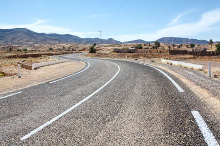 Asphalt way with white road marking in mountain terrain of Africa Stock Photo - 16797629
