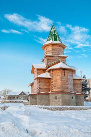 Orthodox wooden church on blue sky in winter season, Russia photo