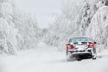 driving conditions: Vehicle standing on winter road and smoke from exhaust pipe