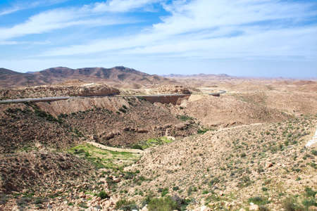 matmata: Asphalt road in Atlas mountains in Matmata, Tunisia Stock Photo