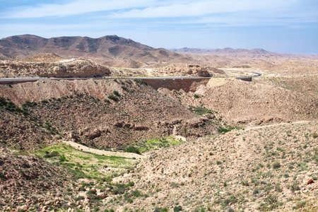 Asphalt road in Atlas mountains in Matmata, Tunisia Stock Photo - 17364169