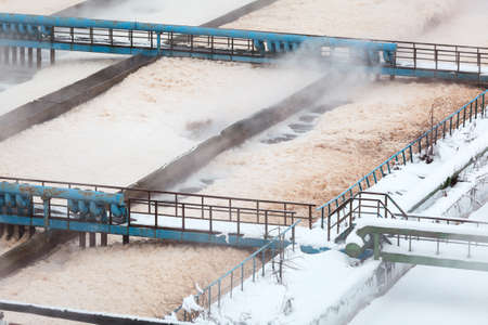 Foam in aeration tanks of sewerage treatment plant photo