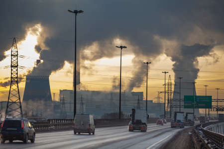 SAINT-PETERSBURG, RUSSIA-DECEMBER 23  City ringway with cars and air pollution from heat electric generation plant on December 23, 2012 in Saint-Petersburg, Russia   Strong vapor and smoke due extreme cold weather 新闻类图片