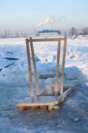obody: Wooden handrail for coming in ice hole water for the Baptism in Saint-Petersburg, Russia Stock Photo