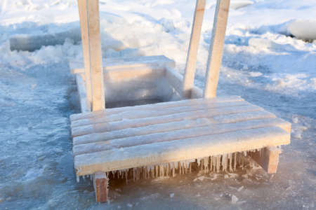 obody: Wooden handrail for dipping in ice hole water for the Baptism in Saint-Petersburg, Russia Stock Photo