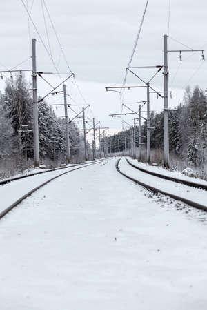 mainline: Empty electric mainline railway in winter woods