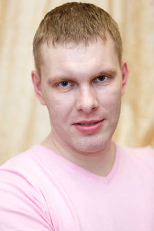 mid adult man: Close up of Caucasian handsome blond hair man in pink t-shirt Stock Photo