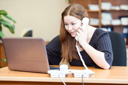 Executive attractive business woman making telephone calls in office