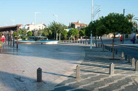 aya: PROTARAS, CYPRUS - CIRCA SEPTEMBER, 2010: Empty street in center of city with fountain, on circa September, 2010 in Protaras, Cyprus.