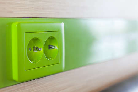 Green appliance receptacle for charging  Close up photo