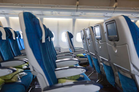 Interior of transcontinental aircraft with comfortable seats photo