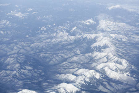 Snowcovered mountain range, Japan. Aerial view photo