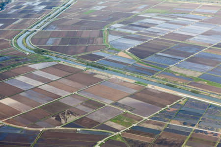 Rice fields from aircraft window  Japanese countryside land  Japan photo