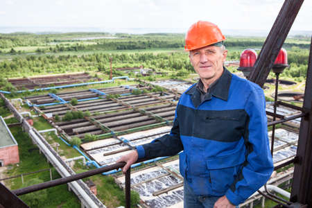 Smiling Caucasian worker standing for high altitude platform  Copyspace photo