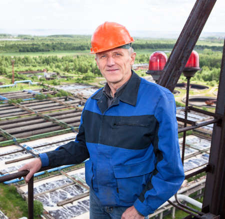 Portrait of handsome worker standing for high altitude platform photo