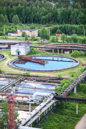 greywater: Round settlers in water treatment plant in summer, outdoors Stock Photo