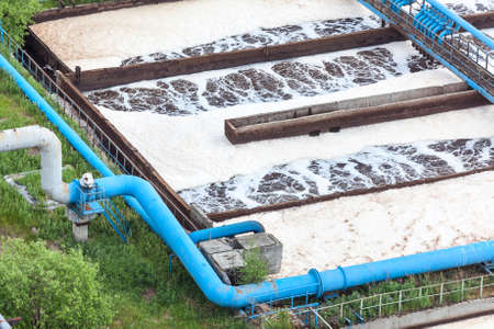 treatment plant: Blue pipelines with oxygen supply for water aeration in an industrial plant Stock Photo