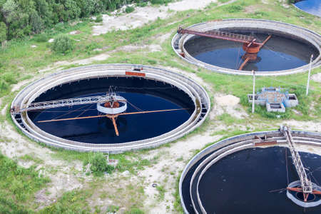 sewer water: Group of wastewater filtering tanks in treatment plant Stock Photo