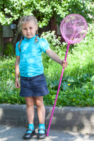 Little Caucasian child full length portrait with butterfly net photo