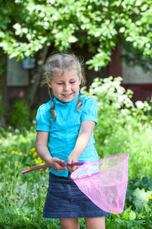 Happy Caucasian child looking in butterfly net photo