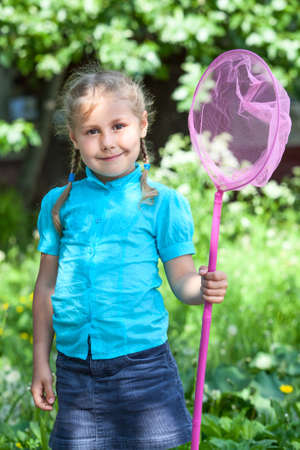 Little Caucasian child portrait with butterfly net photo